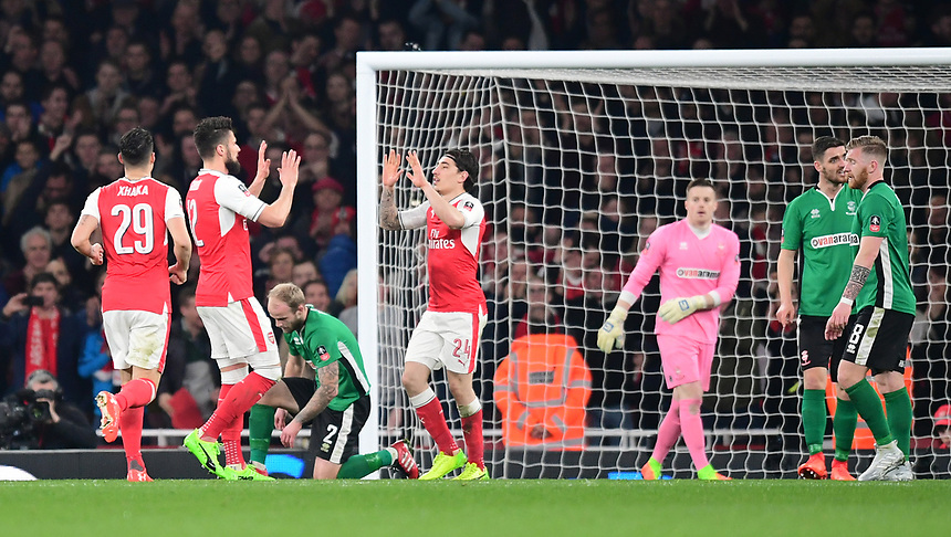 Arsenal's Olivier Giroud, second in from left, celebrates scoring his sides second goal with team-mate Hector Bellerin<br /> <br /> Photographer Chris Vaughan/CameraSport<br /> <br /> The Emirates FA Cup Quarter-Final - Arsenal v Lincoln City - Saturday 11th March 2017 - The Emirates - London<br />  <br /> World Copyright &copy; 2017 CameraSport. All rights reserved. 43 Linden Ave. Countesthorpe. Leicester. England. LE8 5PG - Tel: +44 (0) 116 277 4147 - admin@camerasport.com - www.camerasport.com