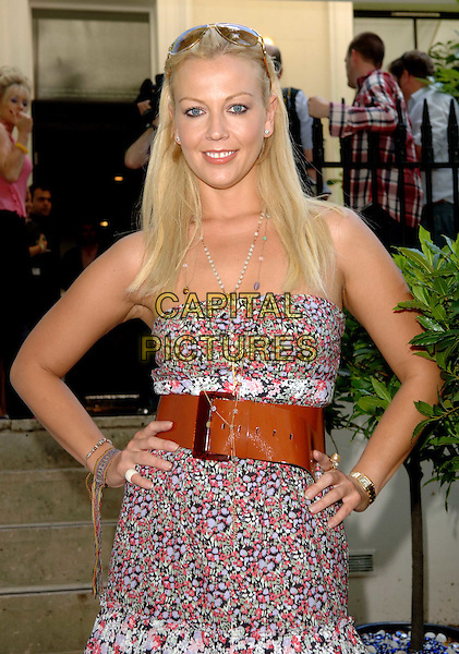 LIZ FULLER.Launch party for the Tara Smith Hair Products, Hemple Hotel, London, England, UK, .July 15th 2008.half length pink floral print dress strapless hands on hip brown belt.CAP/WIZ.© Wizard/Capital Pictures.