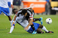 Montreal Impact defender Shavar Thomas (3)  goes against D.C. United forwards Dwayne De Rosario (7) D.C. United tied The Montreal Impact 1-1, at RFK Stadium, Wednesday April 18 , 2012.