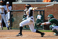 Khayyan Norfork #8 of the Tennessee Volunteers follows through on a swing at Lindsey Nelson Stadium against the the Manhattan Jaspers on March 12, 2011 in Knoxville, Tennessee.  Tennessee won the first game of the double header 11-5.  Photo by Tony Farlow / Four Seam Images...