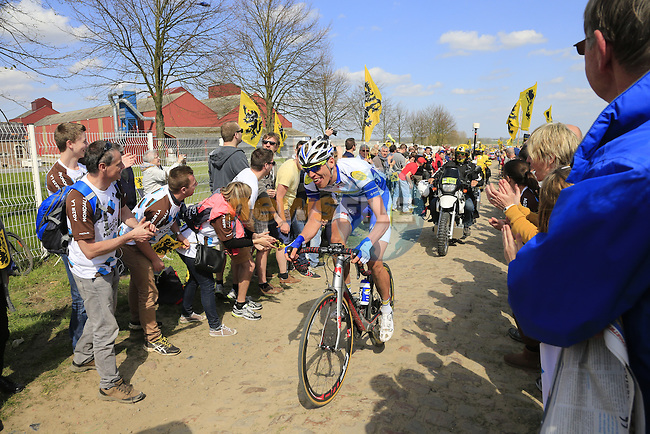 The breakaway group including Tim Declercq (BEL) Topsport Vlaanderen-Balois tackle Sector 10 Mons-en-Pevele during the 113th edition of the Paris-Roubaix 2015 cycle race held over the cobbled roads of Northern France. 12th April 2015.<br /> Photo: Eoin Clarke www.newsfile.ie