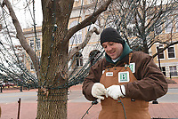 NWA Democrat-Gazette/FLIP PUTTHOFF<br />DOWN COME THE LIGHTS<br />Eugene Venter with Bentonville Parks and Rereation takes down Christmas lights Tuesday Jan. 2 2017 on the Bentonville square. It takes a crew about two weeks to take down and pack away the miles of city Christmas lights, the workers said.