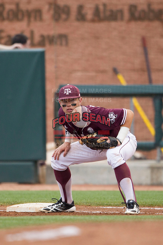 Texas A&M Aggies first baseman Cole Lankford (12) on defense against the LSU Tigers in the NCAA Southeastern Conference baseball game on May 10, 2013 at Blue Bell Park in College Station, Texas. LSU defeated Texas A&M 7-4. (Andrew Woolley/Four Seam Images).
