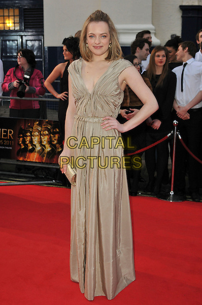 ELISABETH MOSS .Attending The Laurence Olivier Awards, .Theatre Royal, Drury Lane, London.England, UK, March 13th 2011..arrivals full length hand on hip gold ruched dress clutch bag long maxi .CAP/CAS.©Bob Cass/Capital Pictures.