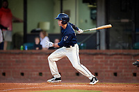 Mobile BayBears second baseman Hutton Moyer (11) follows through on a swing during a game against the Pensacola Blue Wahoos on April 25, 2017 at Hank Aaron Stadium in Mobile, Alabama.  Mobile defeated Pensacola 3-0.  (Mike Janes/Four Seam Images)