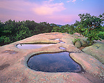 "Elephant Rocks State Park, MO: ""The Birdbath"" pools in a granite outcrop reflect the evening sky's colors"