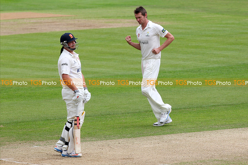 Michael Hogan (R) of Glamorgan celebrates taking the wicket of Jesse Ryder (L) - Essex CCC vs Glamorgan CCC - LV County Championship Division Two Cricket at the Essex County Ground, Chelmsford - 02/06/14 - MANDATORY CREDIT: Gavin Ellis/TGSPHOTO - Self billing applies where appropriate - 0845 094 6026 - contact@tgsphoto.co.uk - NO UNPAID USE