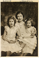 BNPS.co.uk (01202 558833)<br /> Pic: MarcusAdams/ChiswickAuctions/BNPS<br /> <br /> 1936 - Princess Elizabeth aged 10 with Mother and sister Princess Margaret.<br /> <br /> Charming childhood photos of Princess Elizabeth and Princess Margaret have come to light, including a previously unseen image of the future Queen in a kilt.<br /> <br /> The portraits, taken by acclaimed British society photographer Marcus Adams, capture the future Queen from being a baby to her adolescence.<br /> <br /> The Queen Mother would often take her daughters to his central London studio where he would set up toys and props to keep them entertained