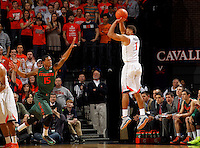 Virginia guard Justin Anderson (1)shoots a there point shot over Miami guard Rion Brown (15) during an NCAA basketball game Saturday Feb, 24, 2014 in Charlottesville, VA. Virginia defeated Miami 65-40.