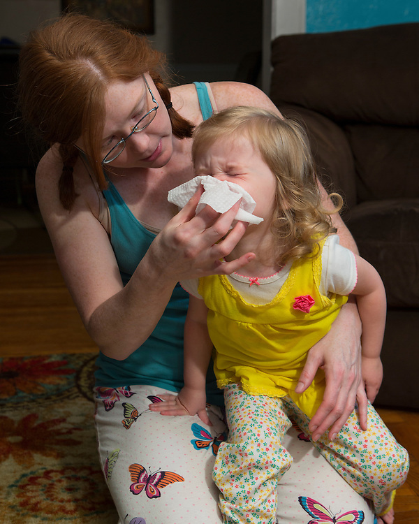 Sarah helps Katelyn blow her nose early in the morning. Sarah is usually awake before 6:30 with the triplets and doesn't typically make it to bed until after 10:30.