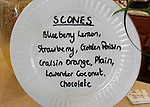 The wide variety of home-made scones available at the Queen's Cuisine Tea Room are listed on a china plate propped up at the counter.