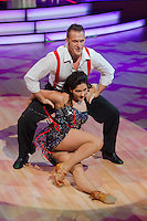 Izabella Varga and Tibor Cseh-Szakal dance in the live broadcast celebrity dancing talent show Saturday Night Fever by Hungarian television company RTL II in Budapest, Hungary on March 16, 2013. ATTILA VOLGYI