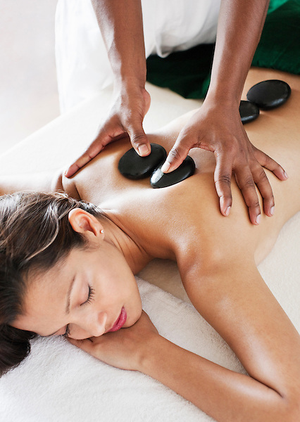 Woman Receiving Hot Stone Massage at Six Senses Spa, Heritance Kandalama Hotel, Dambulla, Sri Lanka. November14,2008. Dambulla, Sri Lanka.