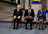 Oslo, Norway - December 10, 2009 -- United States President Barack Obama looks at the Nobel Prize medal during the Nobel Peace Prize ceremony in Raadhuset Main Hall at Oslo City Hall In Oslo, Norway, Thursday, December 10, 2009. .Mandatory Credit: Pete Souza - White House via CNP