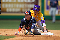 LSU Tigers first baseman Mason Katz #8 and Auburn Tigers second baseman Jordan Ebert #23 look at the second baseman umpire after a pick off attempt in the NCAA baseball game on March 24, 2013 at Alex Box Stadium in Baton Rouge, Louisiana. LSU defeated Auburn 5-1. (Andrew Woolley/Four Seam Images).