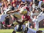 Florida State running back Jacques Patrick picks up eleven yards against Wake Forest's Brad Watson, left, Cameron Glenn, bottom and Marquel Lee in the first half of an NCAA college football game in Tallahassee, Fla., Saturday, Oct. 15, 2016. (AP Photo/Mark Wallheiser)