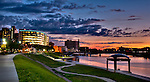 Dayton Ohio skyline at Riverscape walk  at sunset, showing river