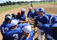 NWA Democrat-Gazette/ANDY SHUPE<br /> Members of the Bootheels team gather Saturday, Aug. 15, 2015, before the start of their game with the Hitmen during the 33rd annual Tyson Foods Corporate Softball Tournament at the Randal Tyson Sports Complex in Springdale.