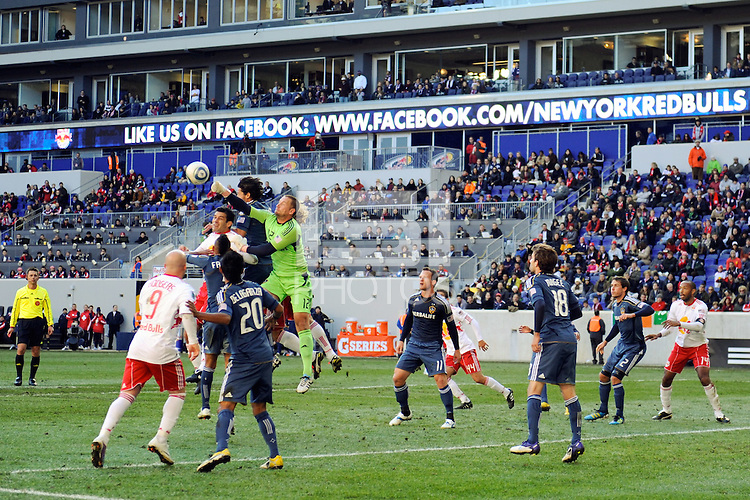 Los Angeles Galaxy goalkeeper Josh Saunders (12) punches a ball clear during the 1st leg of the Major League Soccer (MLS) Western Conference Semifinals against the New York Red Bulls at Red Bull Arena in Harrison, NJ, on October 30, 2011.