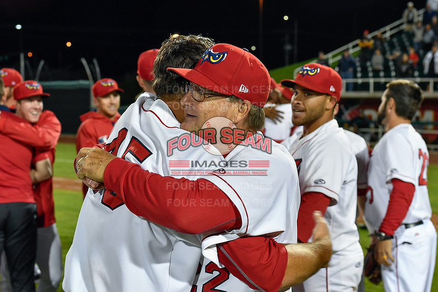 Orem Owlz manager Dave Stapleton (22) hugs Max Bethell (45) after defeating the Billings Mustangs in Game 2 of the Pioneer League Championship at Home of the Owlz on September 16, 2016 in Orem, Utah. Orem defeated Billings 3-2 and are the 2016 Pioneer League Champions. (Stephen Smith/Four Seam Images)