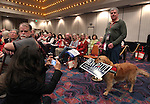 Alexandra Alvarado, of Las Vegas, left, takes a picture of Joel Beck and his dog Sally during the Nevada Republican Party Convention in Sparks, Nev., on Saturday, May 5, 2012..Photo by Cathleen Allison