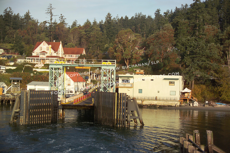 The Orcas Island ferry landing as seen from the water in the early morning November sunshine.  The historic Orcas Hotel (1904) sits just across the road and up the hill from the terminal.