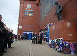 the rev Stuart McQuarrie with Jim Hannah and Paul Murray who read out the names of the dead supporters during the memorial service at Ibrox Stadium