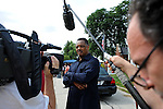 Reverend Jesse Jackson speaks to members of the media at the entrance to the Burr Oak Cemetery, one of the oldest and most historic black American cemeteries on the outskirts of Cook County, the same day four cemetery managers and caretakers were arrested on felony charges of disinterring and dismembering bodies at the cemetery in order to resell the plots to unsuspecting members of the public in Alsip, Illinois on July 9, 2009.