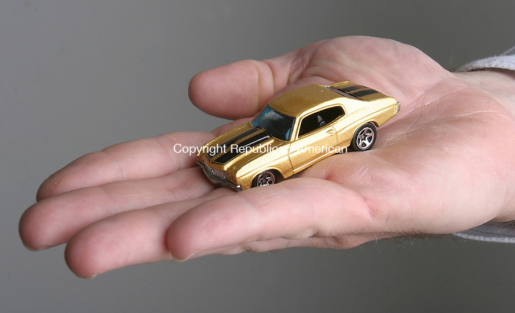 WATERBURY,  CT 28 July 2005 -072805BZ07- To demonstrate scale this photograph shows a 1970 Chevelle SS Hot Wheels car in the palm of a man's hand.<br /> Jamison C. Bazinet Photo