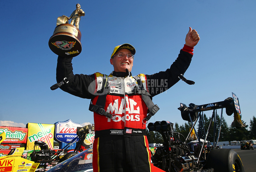 Aug. 3, 2014; Kent, WA, USA; NHRA top fuel dragster driver Doug Kalitta celebrates after winning the Northwest Nationals at Pacific Raceways. Mandatory Credit: Mark J. Rebilas-USA TODAY Sports