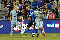 KANSAS CITY, KS - June 1, 2013:<br /> Justin Mapp  (21)midfield Montreal Impact holds off Benny Feilhaber (10) midfield Sporting KC .<br /> Montreal Impact defeated Sporting Kansas City 2-1 at Sporting Park.