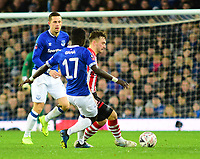 Lincoln City's Lee Frecklington vies for possession with Everton's Idrissa Gueye<br /> <br /> Photographer Andrew Vaughan/CameraSport<br /> <br /> Emirates FA Cup Third Round - Everton v Lincoln City - Saturday 5th January 2019 - Goodison Park - Liverpool<br />  <br /> World Copyright &copy; 2019 CameraSport. All rights reserved. 43 Linden Ave. Countesthorpe. Leicester. England. LE8 5PG - Tel: +44 (0) 116 277 4147 - admin@camerasport.com - www.camerasport.com