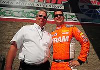 Apr. 1, 2012; Las Vegas, NV, USA: NHRA top fuel dragster driver Spencer Massey with RFC chaplin Craig Garland during the Summitracing.com Nationals at The Strip in Las Vegas. Mandatory Credit: Mark J. Rebilas-