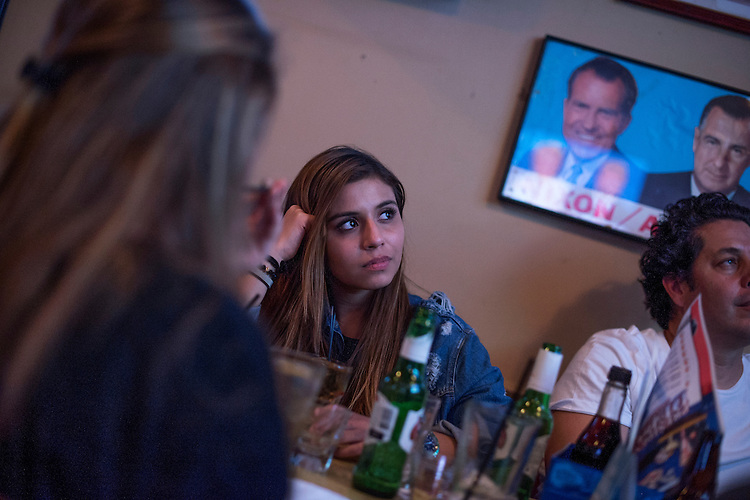 UNITED STATES - OCTOBER 19: Guests watch the last presidential debate between Donald Trump and Hillary Clinton during a watch party at Capitol Lounge on Pennsylvania Avenue, SE, October 19, 2016. (Photo By Tom Williams/CQ Roll Call)