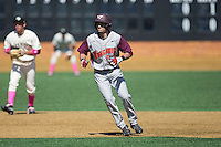 Alex Perez (8) of the Virginia Tech Hokies takes his lead off of second base against the Wake Forest Demon Deacons at Wake Forest Baseball Park on March 7, 2015 in Winston-Salem, North Carolina.  The Hokies defeated the Demon Deacons 12-7 in game one of a double-header.   (Brian Westerholt/Four Seam Images)