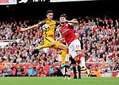 1st October 2017, Emirates Stadium, London, England; EPL Premier League Football, Arsenal versus Brighton; Sead Kolasinac of Arsenal heads the ball clear, as Shane Duffy of Brighton jumps to block