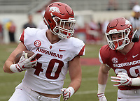 NWA Democrat-Gazette/ANDY SHUPE<br /> Arkansas tight end Trey Purifoy (40) carries the ball Saturday, April 6, 2019, after making a catch as linebacker Asa Shearin pursues him during the Razorbacks' spring game in Razorback Stadium in Fayetteville. Visit nwadg.com/photos to see more photographs from the game.