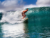 NICARAGUA, San Juan Del Sur, surfer on a wave at Maderas Beach