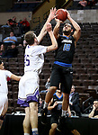 SIOUX FALLS, SD - MARCH 12:  Chandler White #10 from St. Francis shoots over Nate Bruneel #45 from the College of Idaho during their semifinal game at the 2018 NAIA DII Men's Basketball Championship at the Sanford Pentagon in Sioux Falls. (Photo by Dave Eggen/Inertia)