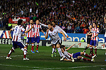 Atletico de Madrid´s Guilherme Siqueira and Tiago Cardoso and Valencia CF´s Shkodran Mustafi celebrates a goal during 2014-15 La Liga match between Atletico de Madrid and Valencia CF at Vicente Calderon stadium in Madrid, Spain. March 08, 2015. (ALTERPHOTOS/Luis Fernandez)