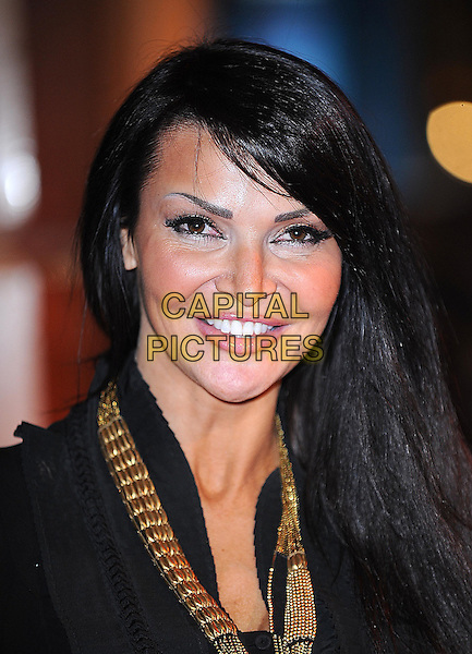 LIZZIE CUNDY.At the UK Premiere of 'Where The Wild Things Are' at the Vue West End, Leicester Square, London, England, UK, December 2nd 2009..portrait headshot  make-up black gold necklace .CAP/BEL.©Tom Belcher/Capital Pictures.