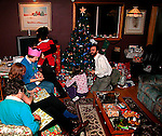 Family opening gifts on Christmas morning