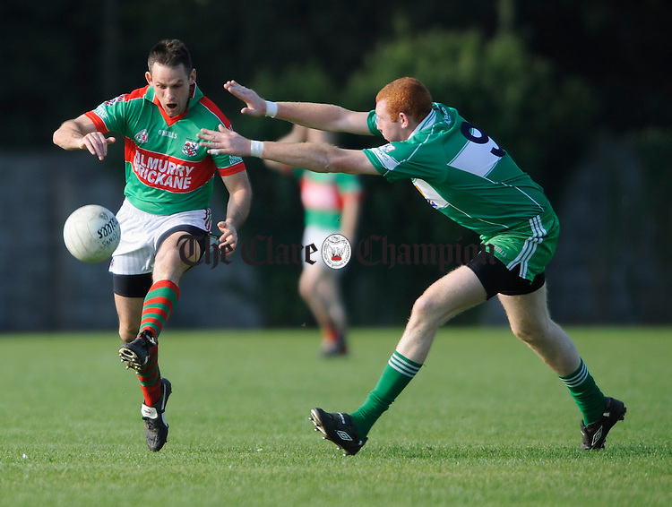 Kilmurry Ibrickane's Odran O Dwyer is tackled by John Bridges of Wolfe Tones  during their championship quarter final at Clareabbey. Photograph by John Kelly.