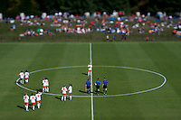 Virginia and the referees take the field at the start of the second half at Klockner Stadium in Charlottesville, VA.  Virginia defeated Maryland, 1-0.