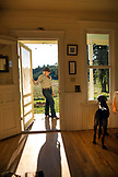 USA, Oregon, Willamette Valley, Clare Carver stands outside her front door at the Big Table Farms Winery, Gaston
