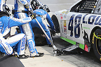 03/23/14 Fontana, CA: Jimmie  Johnson comes into pit road with a shredded tire during the 2014 Auto Club Speedway 400