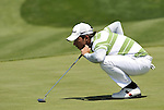JEJU, SOUTH KOREA - APRIL 24:  Pablo Larrazabal of Spain lines up a putt on the 12th green during the Round Two of the Ballantine's Championship at Pinx Golf Club on April 24, 2010 in Jeju island, South Korea. Photo by Victor Fraile / The Power of Sport Images