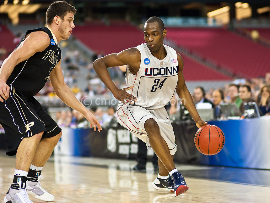 Mar 26, 2009; Glendale, AZ, USA; Connecticut Huskies guard Craig Austrie (24) dribbles past Purdue Boilermakers guard Chris Kramer (3) in the second half of a game in the semifinals of the west region of the 2009 NCAA basketball tournament at University of Phoenix Stadium.