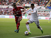 (L-R) Andre Carrillo of Watford against Matrin Olsson of Swansea City during the Premier League match between Swansea City and Watford at The Liberty Stadium, Swansea, Wales, UK. Saturday 23 September 2017