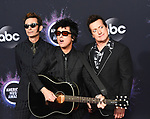 LOS ANGELES, CA - NOVEMBER 24: (L-R) Mike Dirnt, Billie Joe Armstrong, and Tré Cool of Green Day attend the 2019 American Music Awards at Microsoft Theater on November 24, 2019 in Los Angeles, California. Photo: imageSPACE/MediaPunch
